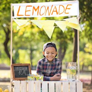 Young boy at lemonade stand